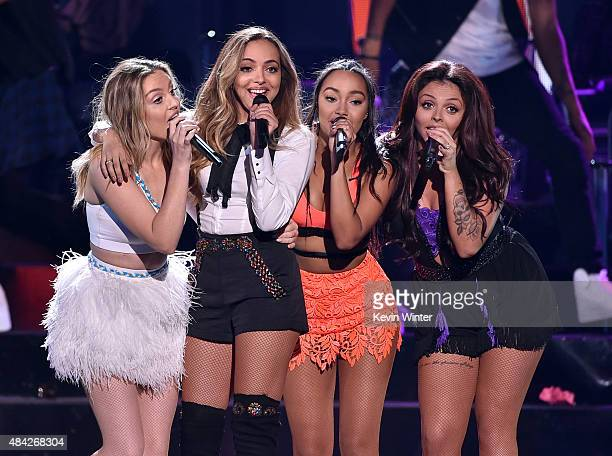 Singers Perrie Edwards Jade Thirlwall LeighAnne Pinnock and Jesy Nelson of Little Mix perform onstage during the Teen Choice Awards 2015 at the USC...