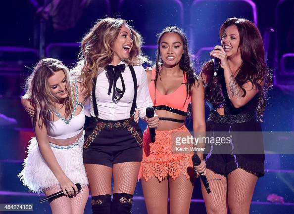 Singers Perrie Edwards Jade Thirlwall LeighAnne Pinnock and Jesy Nelson of Little Mix accept the Choice Music Group Female onstage during the Teen...