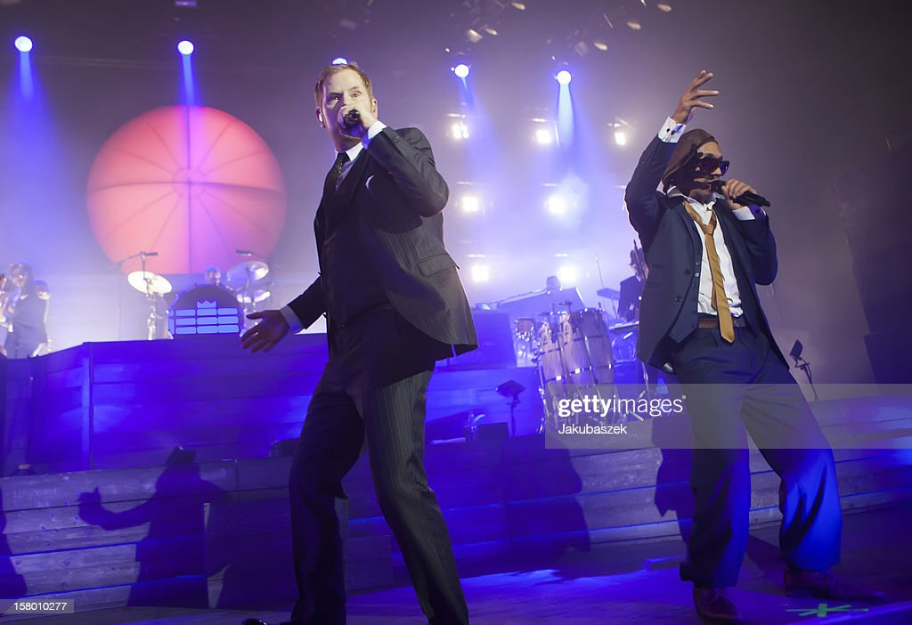 Singers Peter Fox and Boundzound of the German reggae band Seeed perform live during a concert at the Max-Schmeling-Halle on December 8, 2012 in Berlin, Germany.