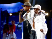 Singers Pharrell Williams and Missy Elliott perform onstage during the BET AWARDS '14 at Nokia Theatre LA LIVE on June 29 2014 in Los Angeles...