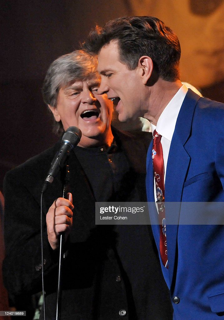 Singers <a gi-track='captionPersonalityLinkClicked' href=/galleries/search?phrase=Phil+Everly&family=editorial&specificpeople=241280 ng-click='$event.stopPropagation()'>Phil Everly</a> (L) and <a gi-track='captionPersonalityLinkClicked' href=/galleries/search?phrase=Chris+Isaak&family=editorial&specificpeople=211544 ng-click='$event.stopPropagation()'>Chris Isaak</a> perform onstage during a concert in celebration of Buddy Holly's music and legacy held at The Music Box Theatre on September 7, 2011 in Hollywood, California.