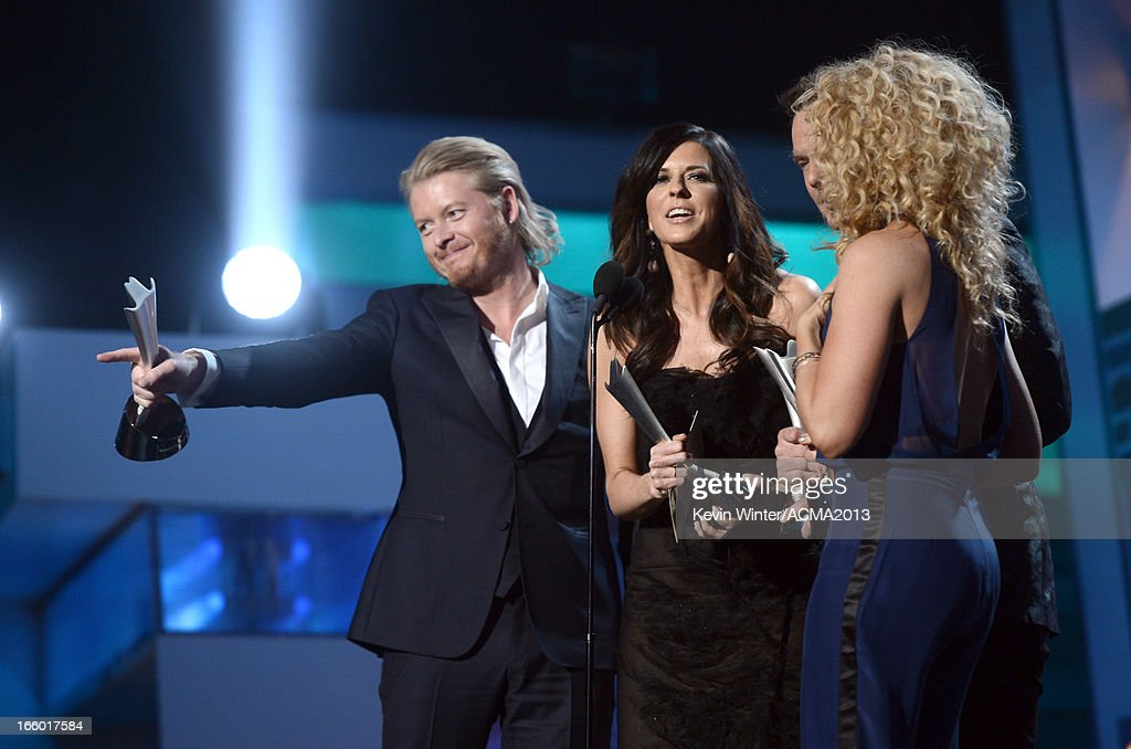 Singers Phillip Sweet, Karen Fairchild, Jimi Westbrook, and Kimberly Schlapman of Little Big Town accept the Vocal Group of the Year award onstage during the 48th Annual Academy of Country Music Awards at the MGM Grand Garden Arena on April 7, 2013 in Las Vegas, Nevada.