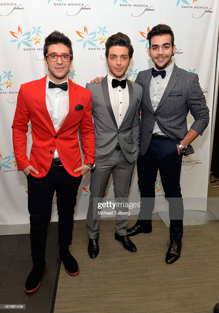 Singers Piero Barone Gianluca Ginoble and Ignazio Boschetto of Il Vilo pose backstage at the unveiling of the HGTV Holiday House at Santa Monica...