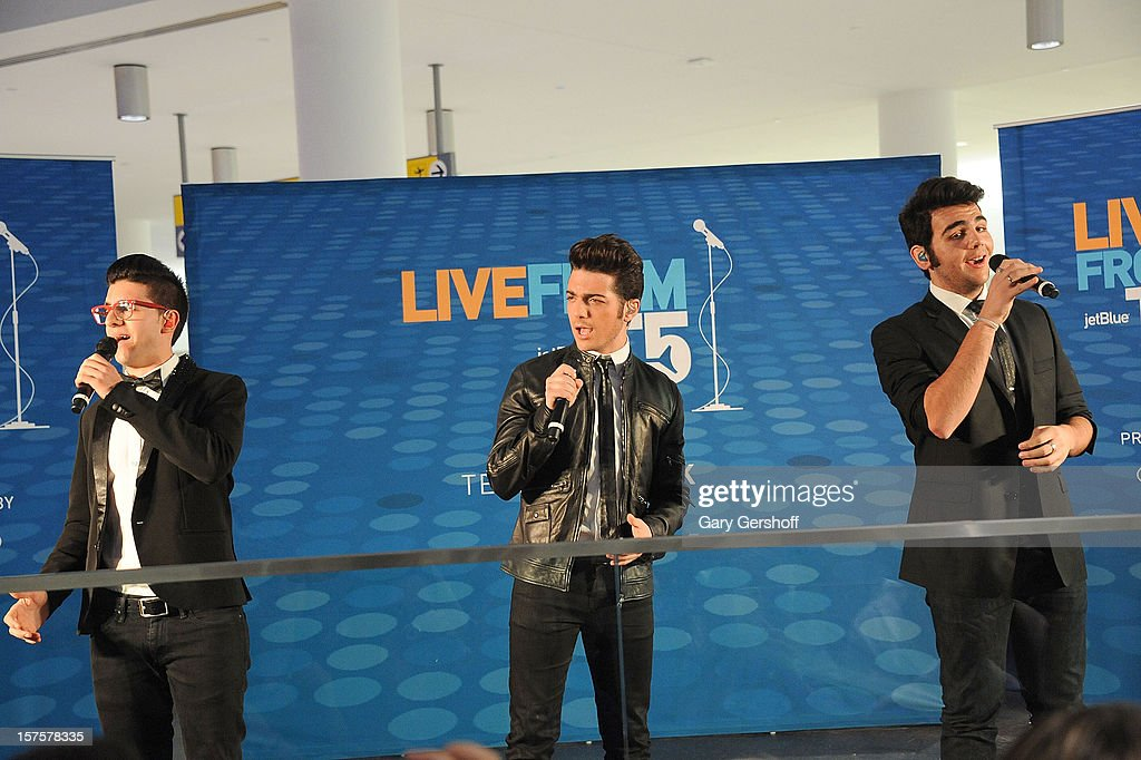 Singers Piero Barone, Gianluca Ginoble and Ignazio Boschetto of ll Volo perform at jetBlue Terminal 5 at JFK Airport on December 4, 2012 in New York City.