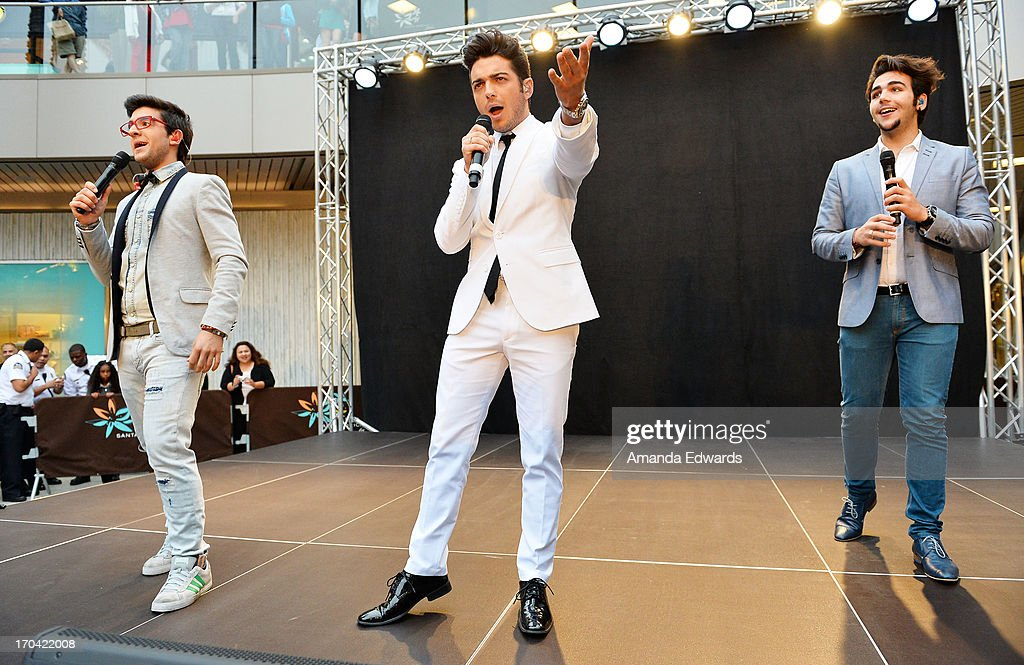 Singers Piero Barone, Gianluca Ginoble and Ignazio Boschetto of the group Il Volo perform onstage before signing copies of their new album 'We Are Love' at Santa Monica Place on June 12, 2013 in Santa Monica, California.