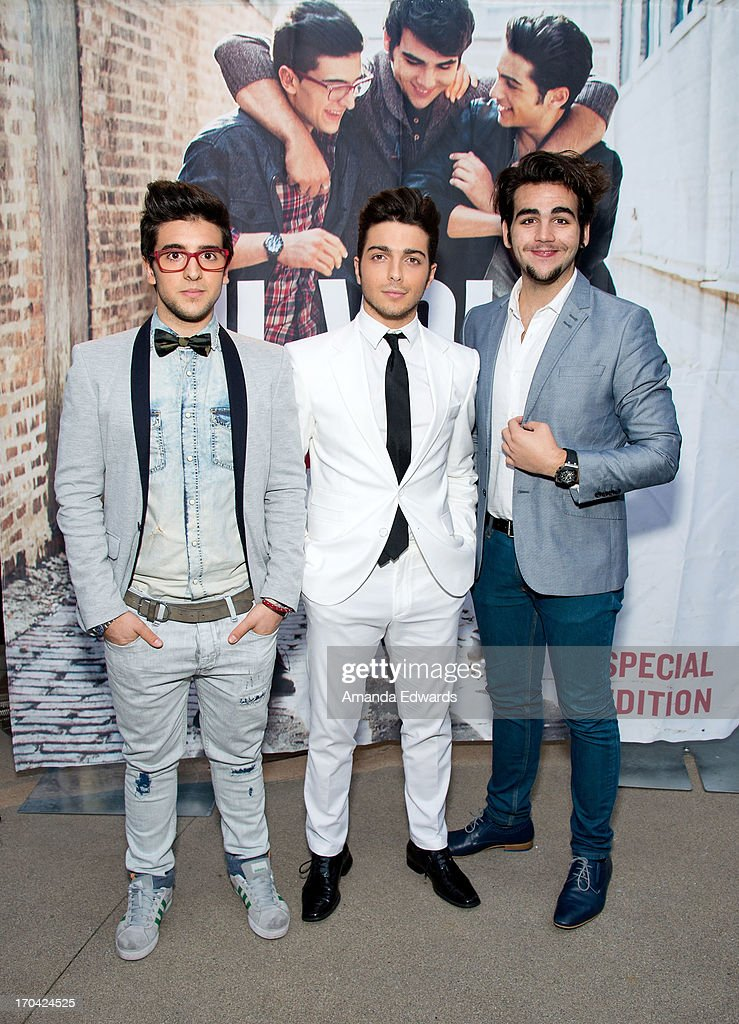 Singers Piero Barone, Gianluca Ginoble and Ignazio Boschetto of the group Il Volo pose before signing copies of their new album 'We Are Love' at Santa Monica Place on June 12, 2013 in Santa Monica, California.