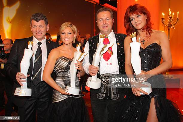 Singers prize winners Semino Rossi Helene Fischer Norbert Rier and Andrea Berg attend the award ceremony 'Krone der Volksmusik' on January 7 2012 in...
