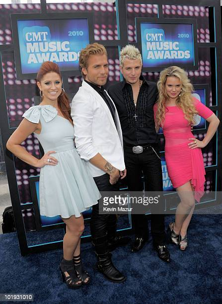 Singers Rachel Reinert Mike Gossin Tom Gossin and Cheyenne Kimball of the band Gloriana attends the 2010 CMT Music Awards at the Bridgestone Arena on...