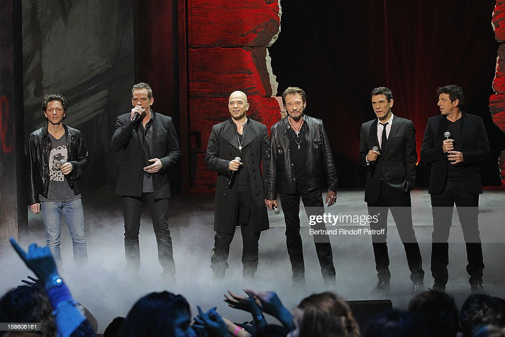 Singers Raphael, Garou, Pascal Obispo, Johnny Hallyday, Marc Lavoine and Patrick Bruel perform during 'La Chanson De L'Annee 2012' Show Recording at Palais des Sports on December 10, 2012 in Paris, France.
