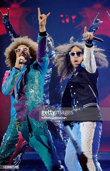 Singers Redfoo and SkyBlu of LMFAO perform onstage at the 2011 American Music Awards held at Nokia Theatre LA LIVE on November 20 2011 in Los Angeles...