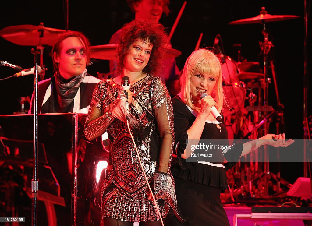 Singers Regine Chassagne and Debbie Harry perform with Arcade Fire onstage during day 3 of the 2014 Coachella Valley Music & Arts Festival at the Empire Polo Club on April 13, 2014 in Indio, California.