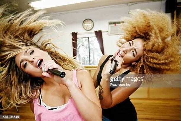 Singers rehearsing in studio