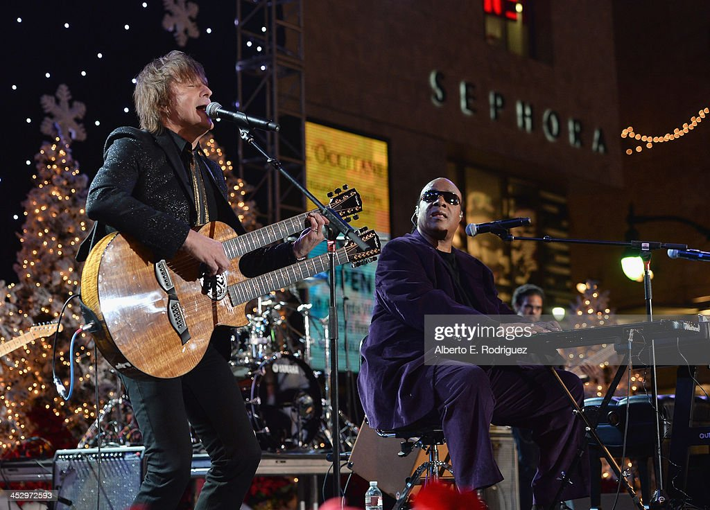 Singers <a gi-track='captionPersonalityLinkClicked' href=/galleries/search?phrase=Richie+Sambora&family=editorial&specificpeople=204195 ng-click='$event.stopPropagation()'>Richie Sambora</a> and <a gi-track='captionPersonalityLinkClicked' href=/galleries/search?phrase=Stevie+Wonder&family=editorial&specificpeople=171911 ng-click='$event.stopPropagation()'>Stevie Wonder</a> perform at the 82nd Annual Hollywood Christmas Parade on December 1, 2013 in Hollywood, California.