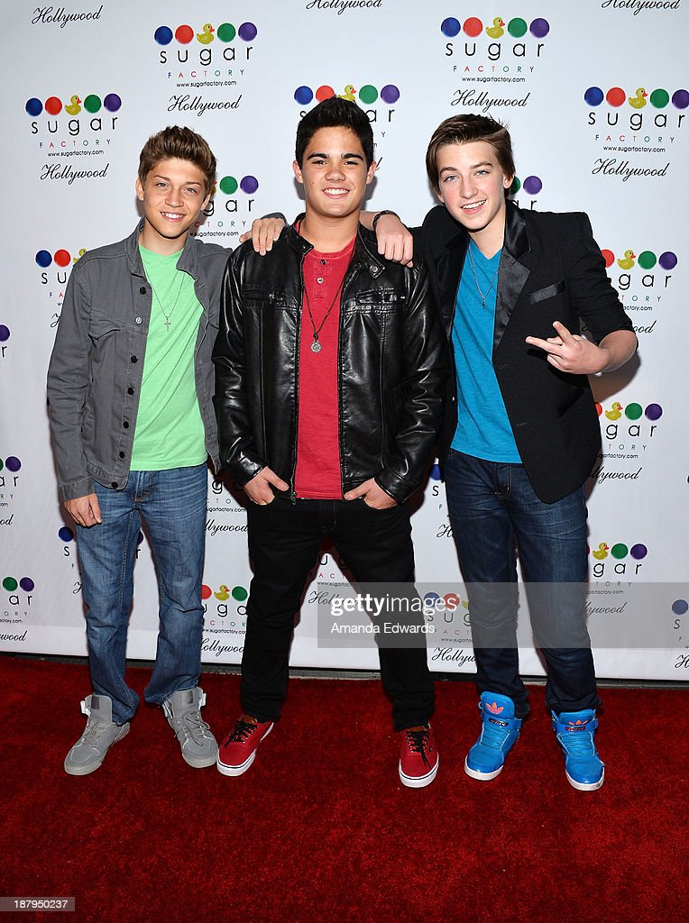 Singers Ricky Garcia, Emery Kelly and Jon Klaasen of the boyband Forever In Your Mind arrive at the grand opening of Sugar Factory Hollywood at Sugar Factory on November 13, 2013 in Hollywood, California.