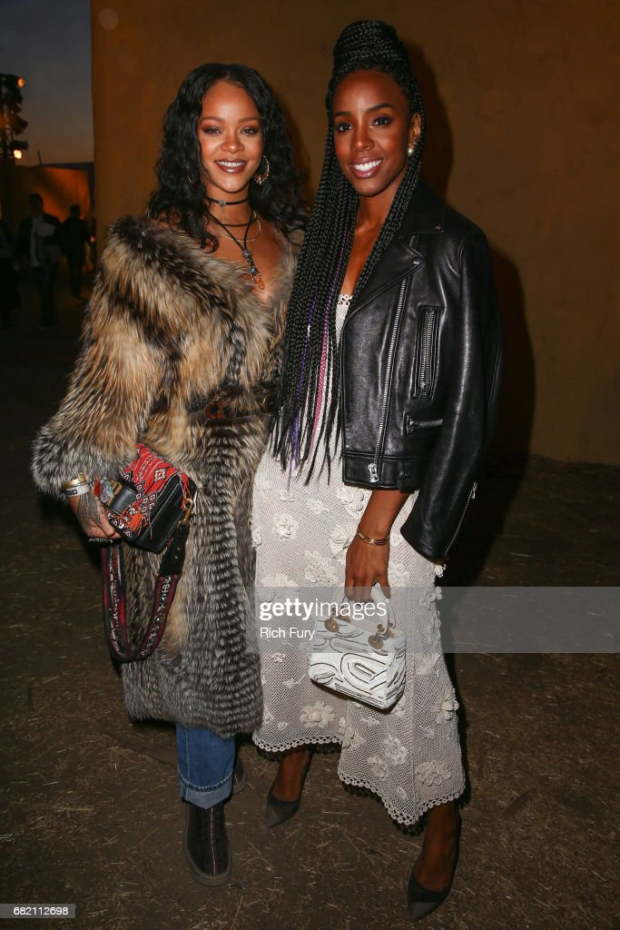 Singers Rihanna (L) and Kelly Rowland attend the Christian Dior Cruise 2018 Runway Show at the Upper Las Virgenes Canyon Open Space Preserve on May 11, 2017 in Santa Monica, California.