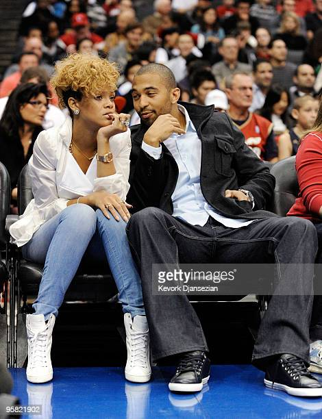 Singers Rihanna and Matt Kemp outfileder of the Los Angeles Dodgers baseball team attend Cleveland Caveliers and Los Angeles Clippers NBA basketball...