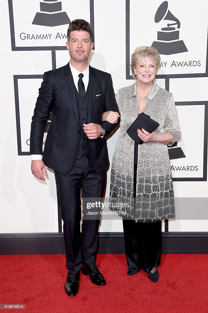 Singers Robin Thicke (L) and Gloria Loring attend The 58th GRAMMY Awards at Staples Center on February 15, 2016 in Los Angeles, California.