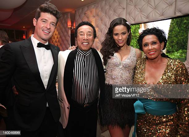 Singers Robin Thicke Smokey Robinson actress Paula Patton and Frances Robinson attend the 2012 Vanity Fair Oscar Party Hosted By Graydon Carter at...