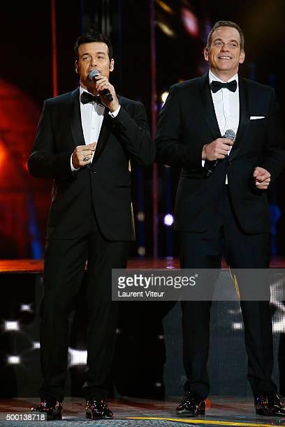 Singers Roch Voisine and Garou attend the 'France Television Telethon 2015'Marc Lavoine at Hippodrome de Longchamp on December 5 2015 in Paris France