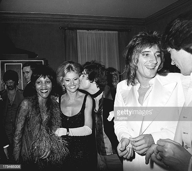 Singers Rod Stewart Mark Bolan Gloria Jones and actress Britt Ekland at a London party circa 1976