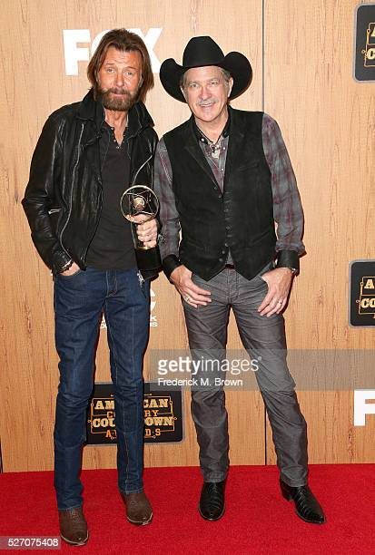 Singers Ronnie Dunn and Kix Brooks of Brooks and Dunn winner of the 'Nash Icon' award pose in the press room during the 2016 American Country...