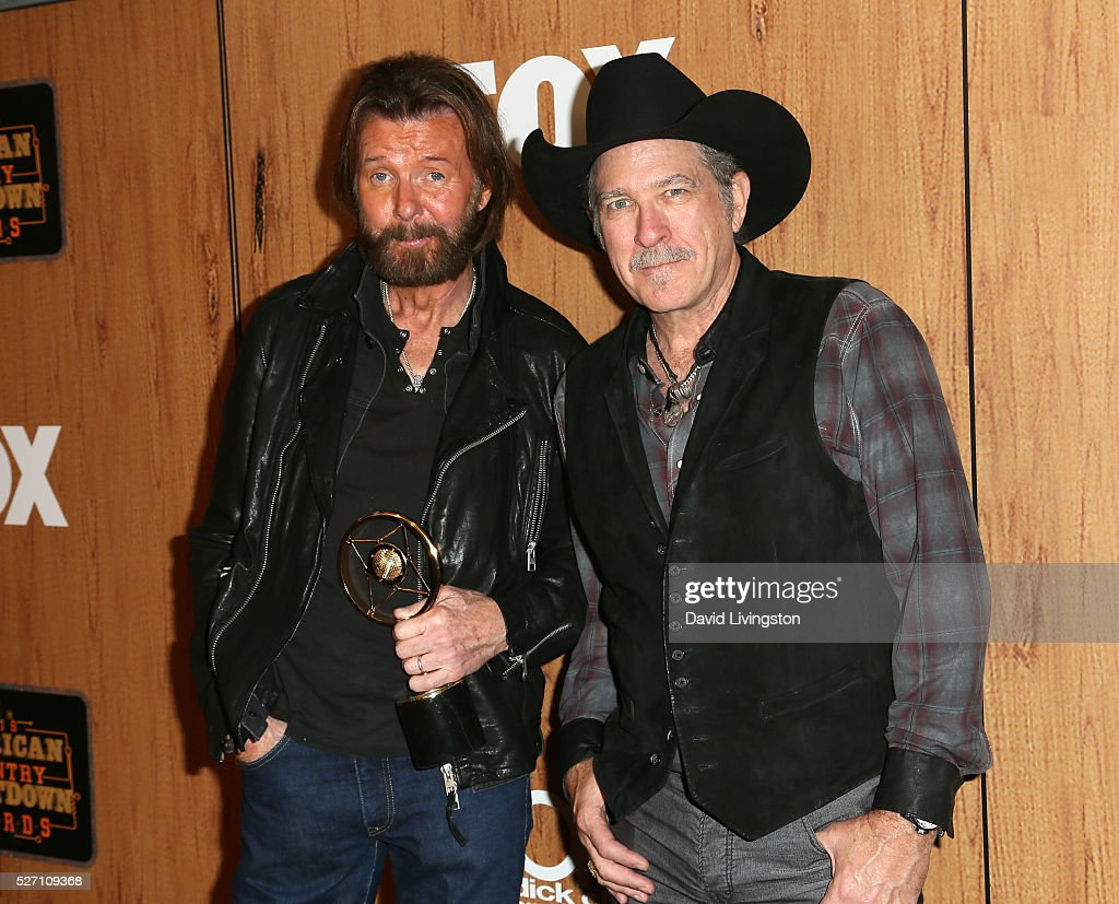 Singers Ronnie Dunn (L) and Kix Brooks of Brooks and Dunn, winners of the 'Nash Icon' award pose in the press room at the 2016 American Country Countdown Awards at The Forum on May 01, 2016 in Inglewood, California.