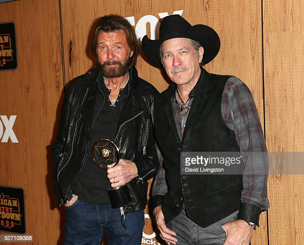 Singers Ronnie Dunn and Kix Brooks of Brooks and Dunn winners of the 'Nash Icon' award pose in the press room at the 2016 American Country Countdown...