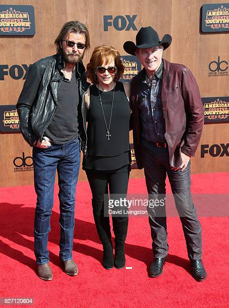 Singers Ronnie Dunn and Kix Brooks of Brooks Dunn and singer Reba McEntire attend the 2016 American Country Countdown Awards at The Forum on May 01...