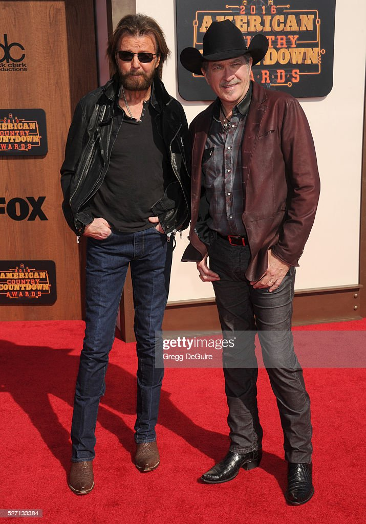 Singers Ronnie Dunn (L) and Kix Brooks (R) of Brooks & Dunn arrive at the 2016 American Country Countdown Awards at The Forum on May 1, 2016 in Inglewood, California.