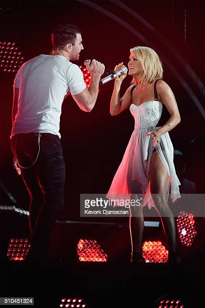 Singers Sam Hunt and Carrie Underwood perform onstage during The 58th GRAMMY Awards at Staples Center on February 15 2016 in Los Angeles California
