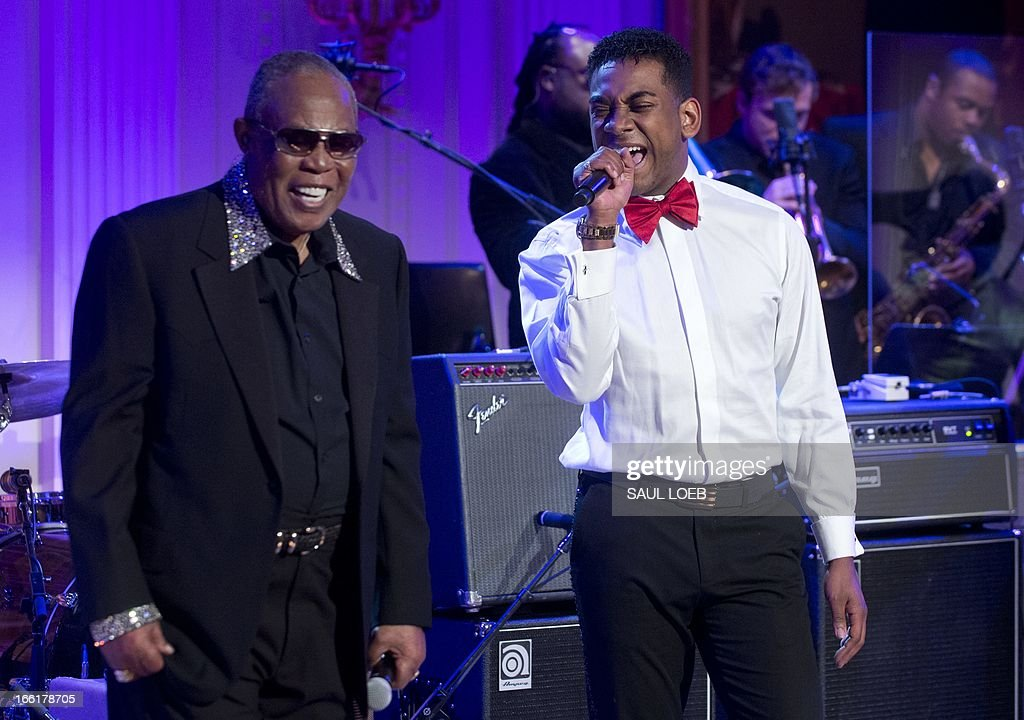 Singers Sam Moore (L) and Joshua Ledet (R) perform 'Soul Man' during a concert in honor of Memphis Soul music in the East Room of the White House in Washington, DC, on April 9, 2013, as part of the 'In Performance at the White House' series. The concert, featuring performances by Justin Timberlake, Booker T. Jones, Ben Harper, Queen Latifiah, among others, is the latest in the series that honors American musicians from all spectrums of musical genres, and airs next week on the PBS television channel. AFP PHOTO / Saul LOEB