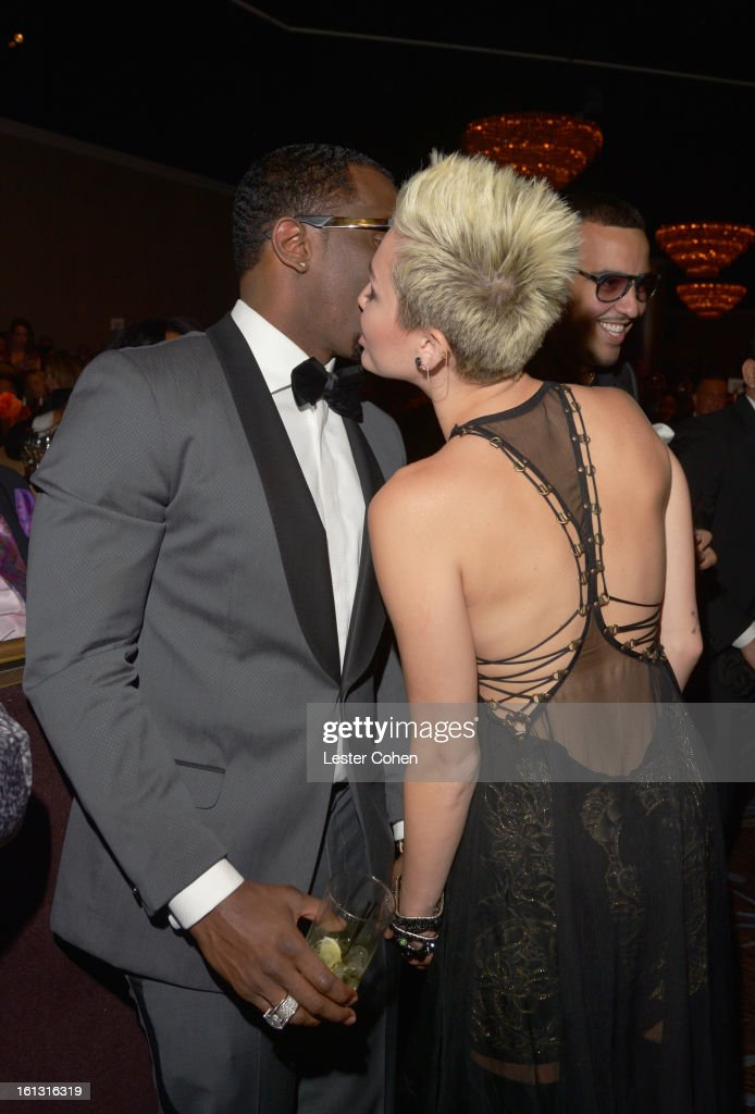 Singers Sean 'Puffy' Combs and <a gi-track='captionPersonalityLinkClicked' href=/galleries/search?phrase=Miley+Cyrus&family=editorial&specificpeople=3973523 ng-click='$event.stopPropagation()'>Miley Cyrus</a> attend the 55th Annual GRAMMY Awards Pre-GRAMMY Gala and Salute to Industry Icons honoring L.A. Reid held at The Beverly Hilton on February 9, 2013 in Los Angeles, California.
