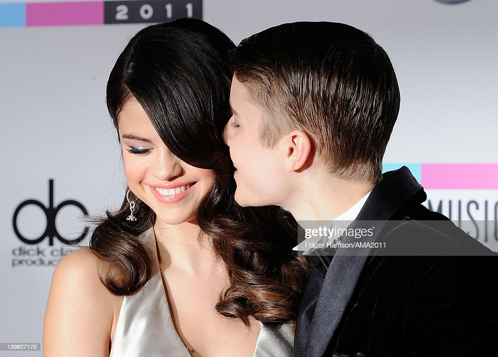 Singers <a gi-track='captionPersonalityLinkClicked' href=/galleries/search?phrase=Selena+Gomez&family=editorial&specificpeople=4295969 ng-click='$event.stopPropagation()'>Selena Gomez</a> and <a gi-track='captionPersonalityLinkClicked' href=/galleries/search?phrase=Justin+Bieber&family=editorial&specificpeople=5780923 ng-click='$event.stopPropagation()'>Justin Bieber</a> arrive at the 2011 American Music Awards held at Nokia Theatre L.A. LIVE on November 20, 2011 in Los Angeles, California.