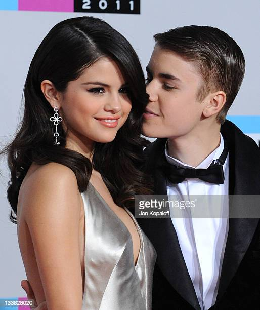 Singers Selena Gomez and Justin Bieber arrive at the 2011 American Music Awards held at Nokia Theatre LA Live on November 20 2011 in Los Angeles...