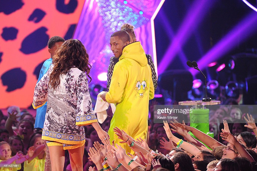 Singers Selena Gomez (L) and Pharrell Williams onstage during Nickelodeon's 27th Annual Kids' Choice Awards held at USC Galen Center on March 29, 2014 in Los Angeles, California.