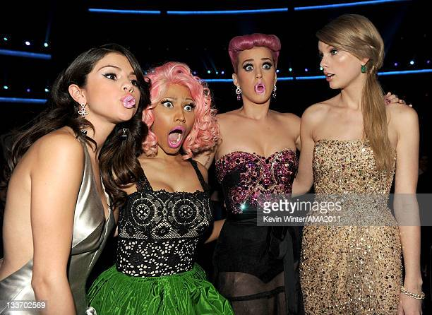Singers Selena Gomez Nicki Minaj Katy Perry and Taylor Swift pose in the audience during the 2011 American Music Awards held at Nokia Theatre LA LIVE...