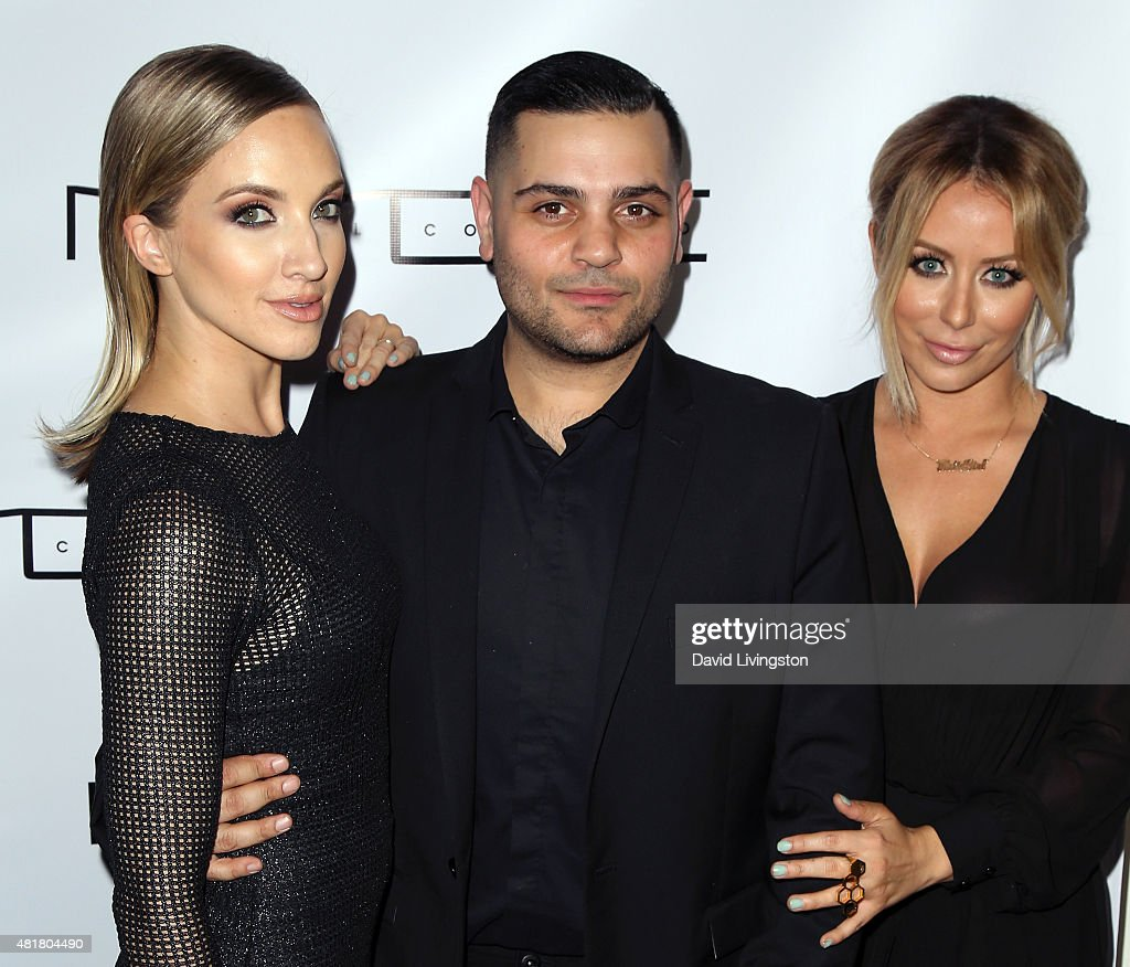 Singers Shannon Bex (L) and Aubrey O'Day (R) of the duo Dumblonde pose with designer Michael Costello at the Michael Costello and Style PR Capsule Collection launch party on July 23, 2015 in Los Angeles, California.