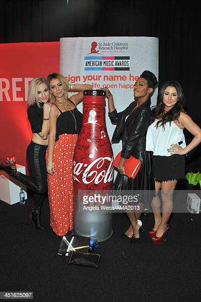 Singers Shannon Bex Aubrey O'Day Dawn Richards and Andrea Fimbres of Danity Kane attend day 2 of the 2013 American Music Awards gift lounge at Nokia...