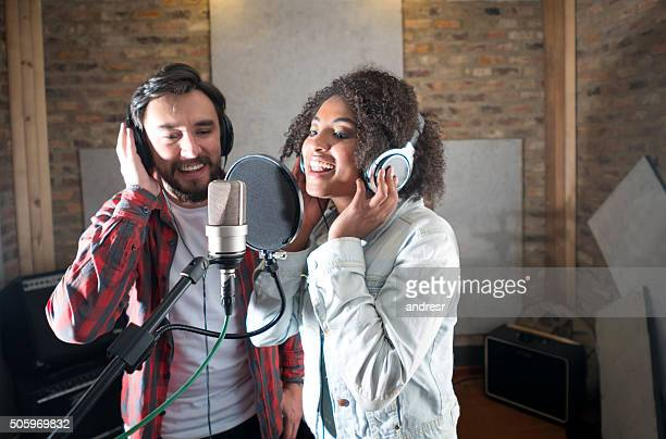 Singers singing at a recording studio