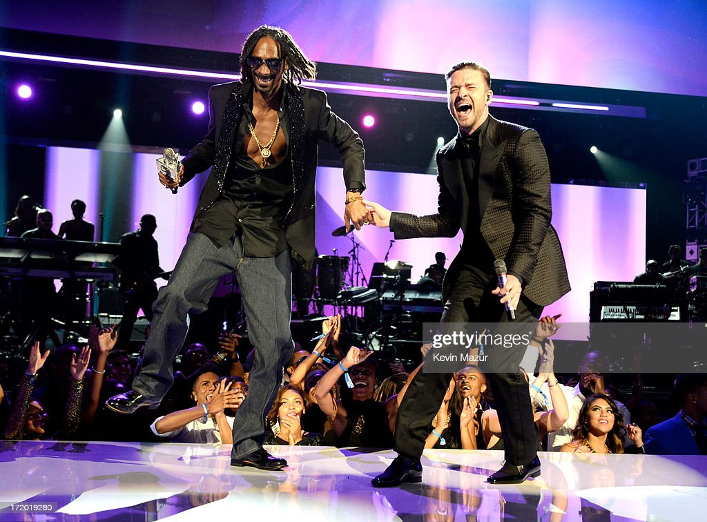 Singers Snoop Lion (L) and <a gi-track='captionPersonalityLinkClicked' href=/galleries/search?phrase=Justin+Timberlake&family=editorial&specificpeople=157482 ng-click='$event.stopPropagation()'>Justin Timberlake</a> perform onstage during the 2013 BET Awards at Nokia Theatre L.A. Live on June 30, 2013 in Los Angeles, California.