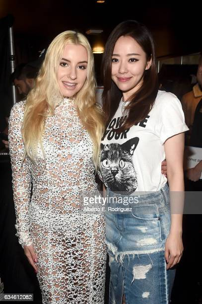 Singers Sophie Beem and Jane Zhang attend Backstage at The GRAMMYs Westwood One Radio Remotes during the 59th GRAMMY Awards at STAPLES Center on...