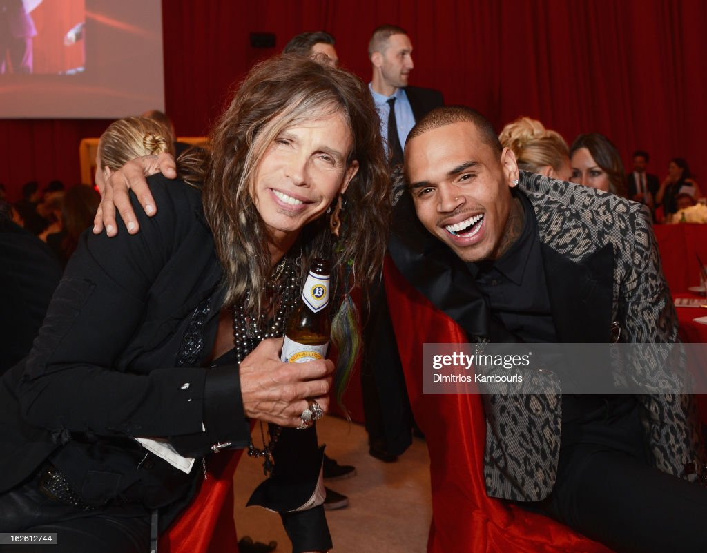 Singers Steven Tyler and Chris Brown attend the 21st Annual Elton John AIDS Foundation Academy Awards Viewing Party at West Hollywood Park on February 24, 2013 in West Hollywood, California.