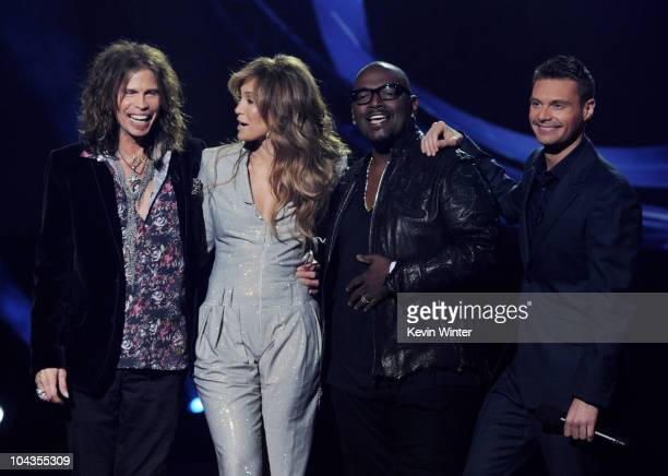 Singers Steven Tyler Jennifer Lopez musician Randy Jackson and host Ryan Seacrest appear onstage at a press conference to officially announce the...