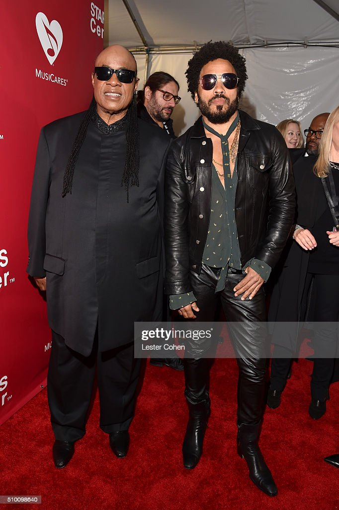 Singers Stevie Wonder (L) and Lenny Kravitz attend the 2016 MusiCares Person of the Year honoring Lionel Richie at the Los Angeles Convention Center on February 13, 2016 in Los Angeles, California.