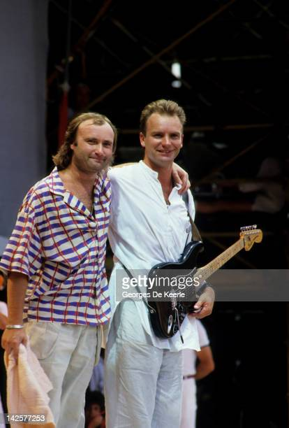 Singers Sting and Phil Collins perform at the Live Aid concert at Wembley Stadium in London 13th July 1985 The concert raised funds for famine relief...