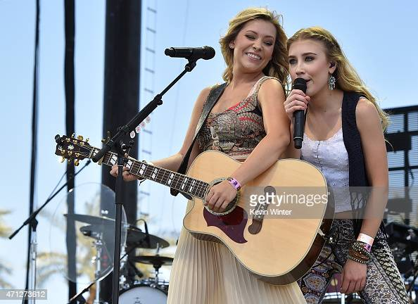 Singers Tae Dye and Maddie Marlow of Maddie Tae perform onstage during day three of 2015 Stagecoach California's Country Music Festival at The Empire...