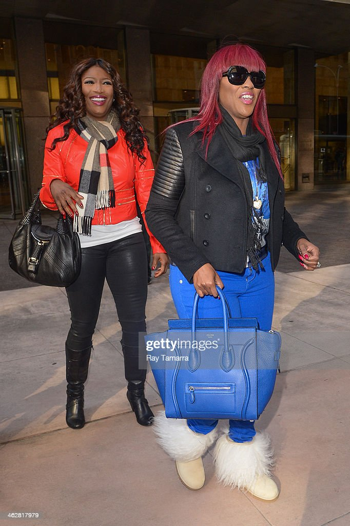Singers Tamara 'Taj' Johnson-George (L) and Cheryl Elizabeth 'Coko' Clemons, of SWV, enter the Sirius XM Studios on January 15, 2014 in New York City.