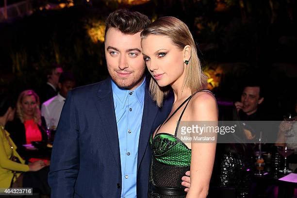 Singers Taylor Swift and Sam Smith attend the Elle Style Awards 2015 at Sky Garden @ The Walkie Talkie Tower on February 24 2015 in London England