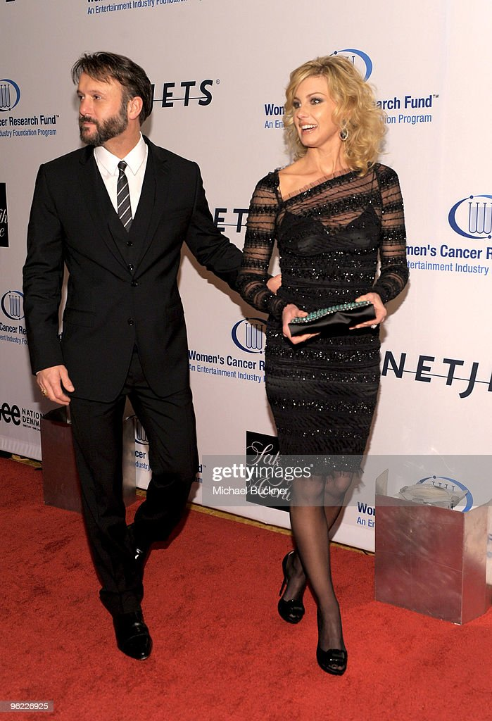 Singers Tim McGraw (L) and Faith Hill arrive at An Unforgettable Evening Benefiting EIF's Women's Cancer Research Fund at Beverly Wilshire Four Seasons Hotel on January 27, 2010 in Beverly Hills, California.