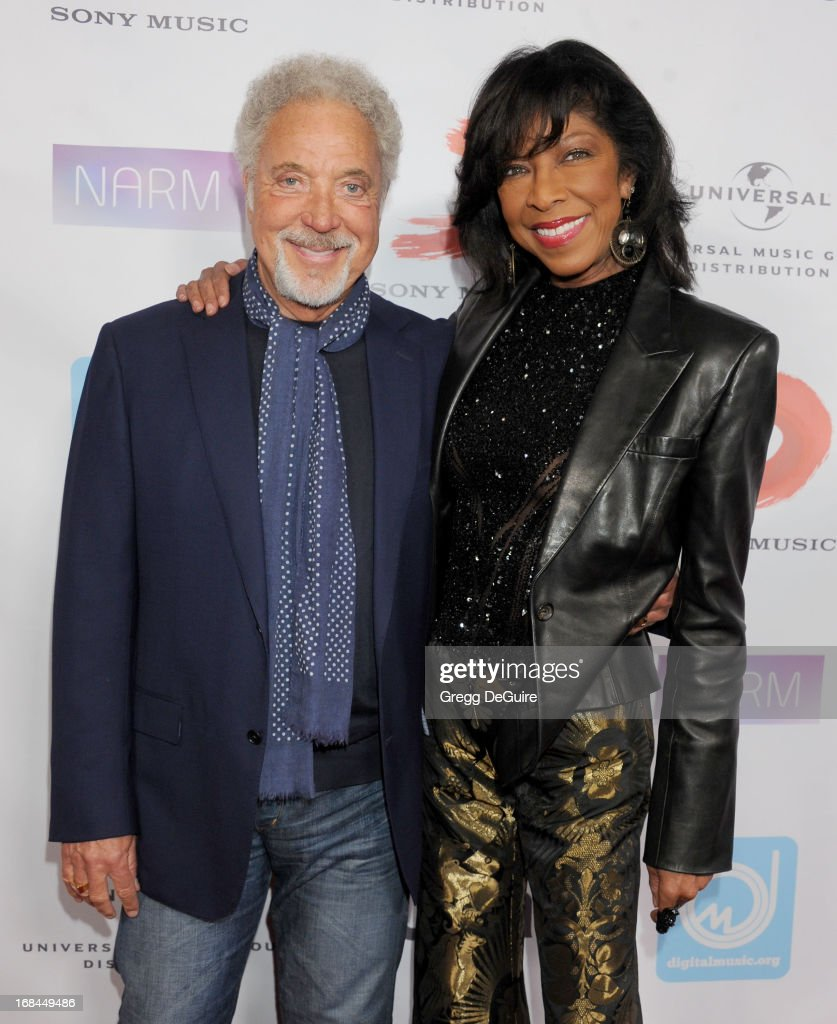 Singers Tom Jones and Natalie Cole arrive at the NARM Music Biz Awards dinner party at the Hyatt Regency Century Plaza on May 9, 2013 in Century City, California.